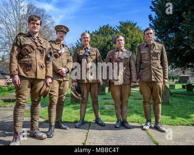 Great Budworth, UK. 9th April, 2018. extras pose dressed in Royal Artillery costumes in churchyard , starring in the new BBC drama 'War Of The Worlds' by HG Wells,filmed at Great Budworth village, Cheshire on Monday afternoon, April 9th. Credit: Ian Hubball/Alamy Live News - Stock Photo