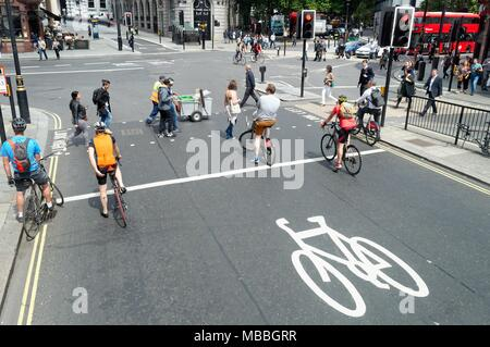 Cyclists waiting at red traffic lights on the Strand Central London England UK - Stock Photo