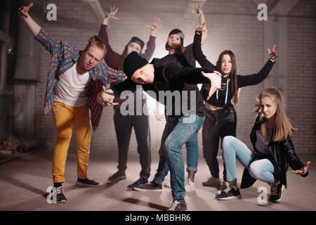 young people are taking up challenge from their friends - Stock Photo