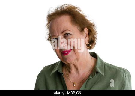 Portrait of smiling senior lady against white background - Stock Photo