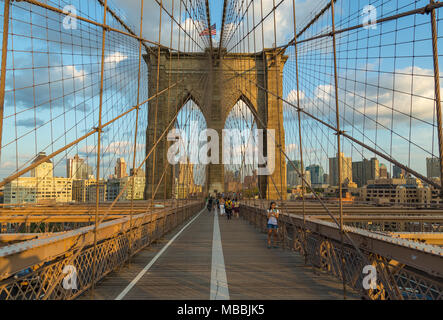 New York, NYC, USA- August 30, 2017: View of Brooklyn Bridge from Brooklyn. Hybrid cable-stayed - suspension bridge in New York City. Summer evening i - Stock Photo