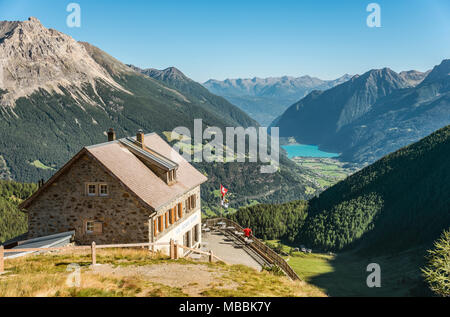 Mountain hut at Alp Gruem, with the Valposchiavo in the background, Engadin, Switzerland | Berghuette an Alp Grüm, mit dem Valposchiavo im Hintergrund - Stock Photo