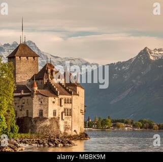 Chillon Castle (Château de Chillon) located on the shore of Lake Geneva in Montreux; Switzerland - Stock Photo