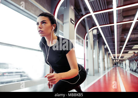 Female athlete in position ready to run. woman ready for sprint. - Stock Photo