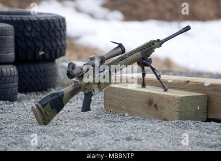 A M110 Semi-Automatic Sniper System sits on the firing line on Statler range at Joint Base Elmendorf-Richardson, Alaska, before paratroopers assigned to the 1st Squadron, 40th Cavalry Regiment (Airborne), 4th Infantry Brigade Combat Team (Airborne), 25th Infantry Division, U.S. Army Alaska, hone marksmanship skills, April 6, 2018.  A sniper's main responsibility is to deliver discriminatory, highly accurate rifle fire against enemy targets that cannot be engaged successfully by the regular rifleman due to range, size, location, fleeting nature, or visibility. (U.S. Air Force photo/Justin Conna - Stock Photo