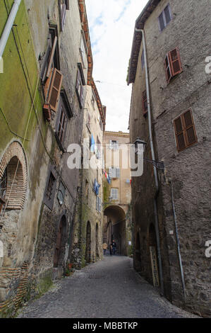 ROME, ITALY - JANUARY 20, 2010: View of typical narrow street of the old town in Bracciano. Bracciano is a small old town in Lazio, Italy. - Stock Photo