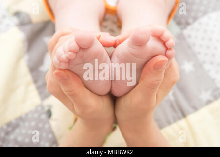 Heels of an infant, a child - Stock Photo