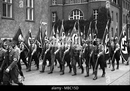 Sturmabteilung also called stormtoopers and Brownshirts carrying Swastika Flags in 1934 as they parade through Konigsberg in Germany. Konigsberg became Russian territory after the second world war and was renamed Kaliningrad. Deutschland 1930s - Stock Photo
