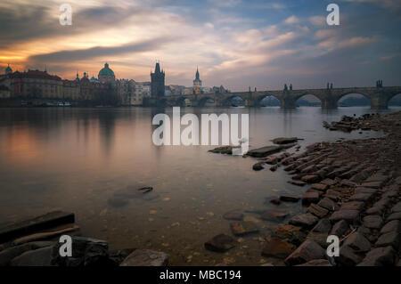 Charles bridge during foggy sunrise, Prague, Czech republic - Stock Photo