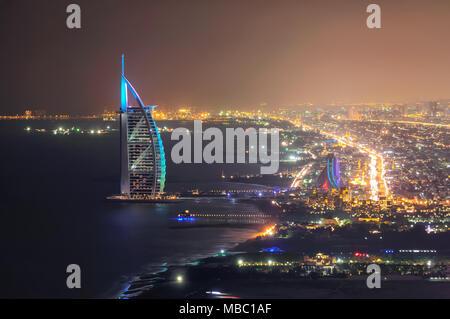 DUBAI, UAE - MAR 18, 2014: Famous Jumeirah beach view with 7 star hotel Burj Al Arab, Dubai, United Arab Emirates - Stock Photo