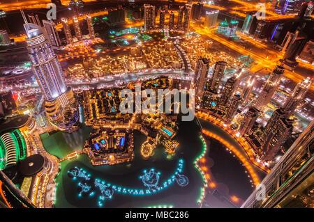 Dubai downtown aerial view by night, Dubai, United Arab Emirates - Stock Photo