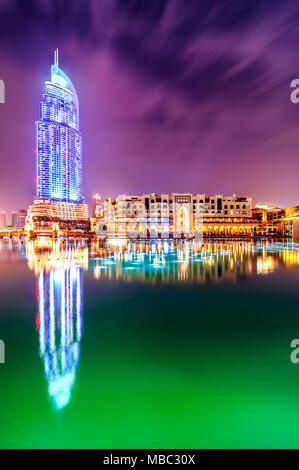 DUBAI, UAE - APR 7, 2013: Amazing night dubai downtown skyline with hotel The Address and traditional shop Souk Al Bahar, Dubai, United Arab Emirates - Stock Photo