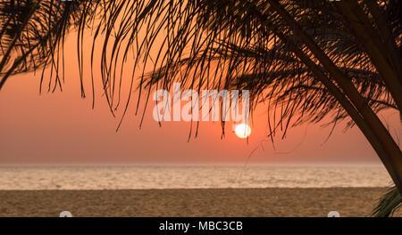 Sunset over a deserted beach in Sri Lanka - Stock Photo