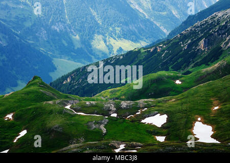 Detail of mountain landscape. Beautiful spring view at Grossglockner High Alpine Road Hochtor Pass. Green valley with snow. Highest mountain pass road - Stock Photo
