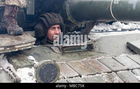 Yavoriv, Ukraine – A Ukrainian Army Soldier assigned to 3rd Battalion, 14th Mechanized Brigade, operates a T-64B tank during a live-fire exercise conducted at the Yavoriv Combat Training Center (CTC)  here Feb. 14. Currently the 3-14th is completing a training rotation at the CTC where they will be mentored by U.S., Canadian, Lithuanian, Polish, and U.K. service members as they strive toward attaining their goal of achieving NATO interoperability. (U.S. Army - Stock Photo