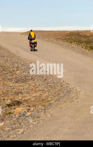 Off-road cycling, solo travel, male cyclist travelling by himself on road F35, Kjalvegur, interior of Iceland, Europe. - Stock Photo