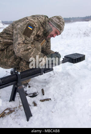 Yavoriv, Ukraine -- A Ukrainian Soldier assigned to 3rd Battalion, 14th Mechanized Brigade adjusts the sights on a DshK machine gun at the Yavoriv Combat Training Center here Feb. 16. Currently the 3-14th is completing a training rotation at the CTC where they will be mentored by U.S., Canadian, Lithuanian, Polish, and U.K service members as they strive toward attaining their goal of achieving NATO interoperability. (U.S. Army - Stock Photo