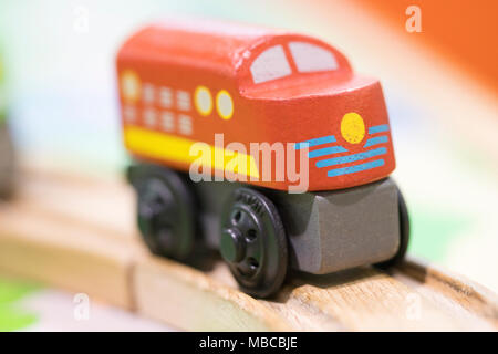 Wooden toy Red train - Toys for kids Play set Educational toys for preschool indoor playground(selective focus) - Stock Photo