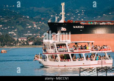 Batumi, Adjara, Georgia - September 10, 2017: Small Pleasure Boat Tourist Boat Floating From Port For Cruise Near Coast In Sunny Summer Evening - Stock Photo