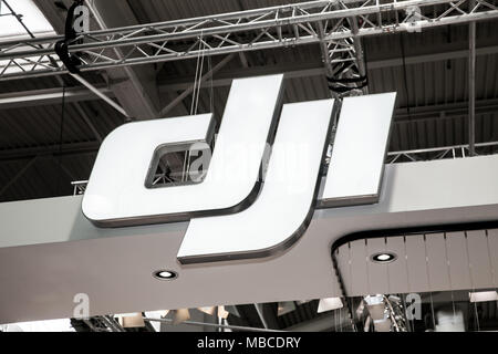 DJI company logo sign on exhibition fair Cebit 2017 in Hannover Messe, Germany - Stock Photo