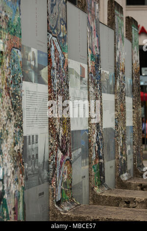 A section of the Berlin Wall on display at Potsdamerplatz. - Stock Photo