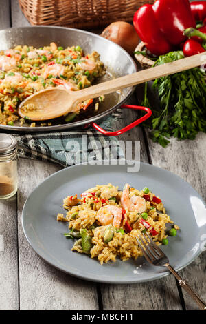 Traditional seafood paella with shrimp, fish and chicken seved in plate. Spanish cuisine Stock Photo