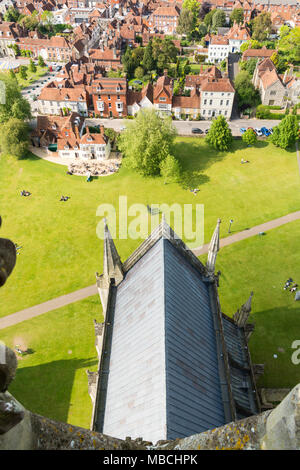 Looking down onto the leaded roof of a nave of Salisbury Cathedral and some city houses rooftops, from the tallest spire in Britain, Wiltshire, UK - Stock Photo