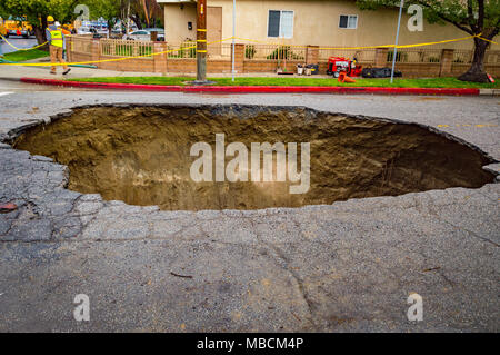 Los Angeles, California, USA. 18th February, 2017. Sinkhole swallows vehicle in Studio City, California. - Stock Photo