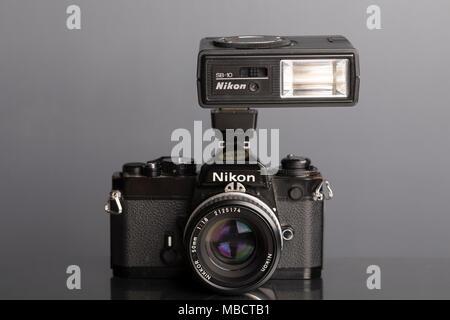 Nikon FE 35mm SLR single lens reflex film camera with SB-10 Speedlight flash - Stock Photo