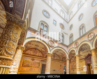 Florence, Italy, June 2015: inside courtyard of Palazzo Vecchio (old palace) in Florence with decorated columns, arches and frescoes depicting the Aus - Stock Photo