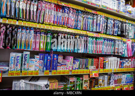 Tokyo Japan Shinjuku drugstore pharmacy kanji hiragana katakana characters symbols Japanese English retail display packaging com - Stock Photo