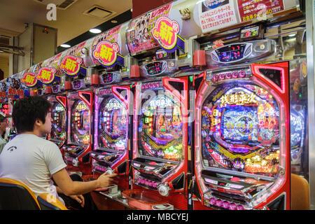 Tokyo Japan Ryogoku kanji hiragana katakana characters symbols pachinko parlor gambling prizes vertical pinball machine Asian ma - Stock Photo