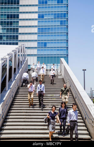 Tokyo Japan Akihabara office buildings steps stairs workers Asian man men woman women UDX building - Stock Photo