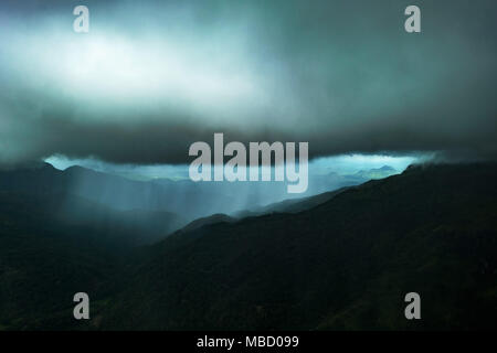 Dramatic view in the mountains during heavy rain. - Stock Photo