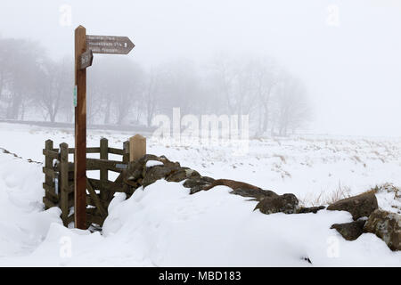 Hadrian's Wall in winter - the public footpath leading towards Peel Crags from close to the Steel Rigg car park - Stock Photo