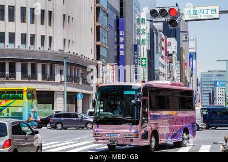 Tokyo Japan Ginza Chuo & Harumi Dori Street kanji hiragana katakana characters symbols Japanese English shopping street scene bu - Stock Photo