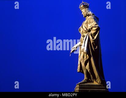 Statue of Charles VI on the eastern bank of the Vltava river, by the Charles Bridge.  Charles VI is said to have been Europe's last initiate ruler. Charles VI the Well-Beloved, later known as the Mad (French: Charles VI le Bien-Aimé, later known as le Fol) (December 3, 1368 - October 21, 1422) was a King of France (1380-1422) and a member of the Valois Dynasty. He was born in Paris, the son of King Charles V and Jeanne de Bourbon. At the age of eleven, he was crowned King of France in 1380 in the cathedral at Reims. Until he took complete charge as king in 1388, France was run by his uncle, Ph - Stock Photo