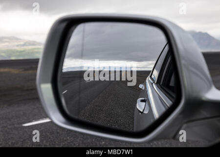 A Remote Section of the Icelandic Ring Road Viewed Through a Car Mirror, Iceland, - Stock Photo