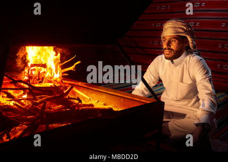 Portrait of Bedouin young man, Wadi Rum Desert, Jordan - Stock Photo