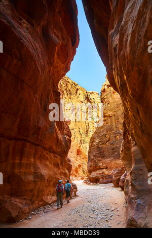 The Siq - narrow gorge canyon leads into the ancient city of Petra, Jordan - Stock Photo