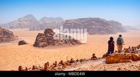 Tourists in the Wadi Rum Desert, Jordan - Stock Photo