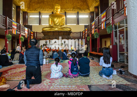 Upon the Khmer New Year celebration, people from the southeast asian community attend the ceremony and pray Buddha in the Great Pagoda of Vincennes. - Stock Photo