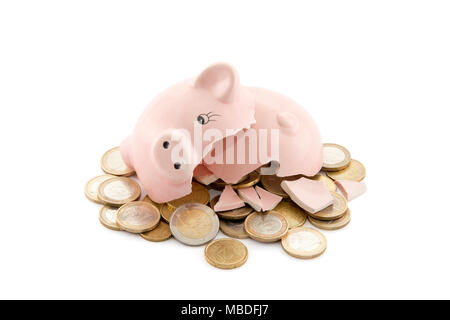 Broken piggy bank with Euro coins on white background with clipping path - Stock Photo