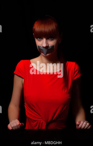 girl with tape lips - Stock Photo