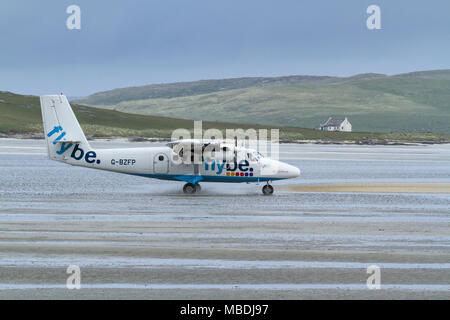 DHC Twin Otter passenger aeroplane taxying prior to take off from Barra Airport, Isle of Barra, Outer Hebrides, Scotland - Stock Photo