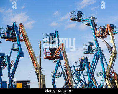 Aerial work platforms or 'cherrypickers'. The term 'Cherrypicking' has been widely used in the UK/EU Brexit negotiations - Stock Photo