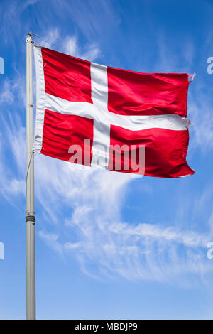 The Denmak national flag flying in the wind. - Stock Photo