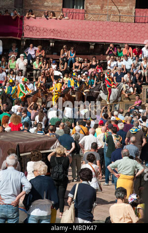 Palio di Siena, Tuscany, Italy.  Colourful historical bareback horse race. Held in the beautiful, historical Piazza del Campo. Exciting event.