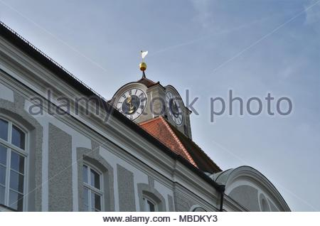 beautiful decorated clock at Nymphenburg castle in Munich in Germany during spring - Stock Photo
