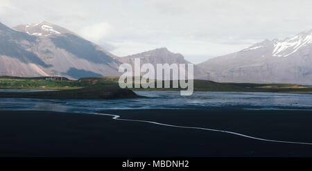 Typical Iceland landscape with road and mountains. - Stock Photo